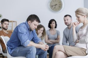 Man making confession during support group meeting