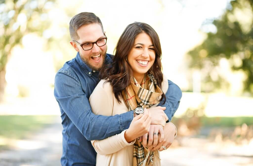 A portrait image of a happy woman and man, how to help someone with addiction, how to help an addict, how addiction affects your family, effects of addiction on family and friends, addictions may al