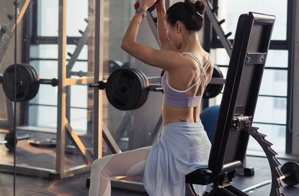 An image of a woman exercising in the gym, stress management, ways to manage stress, healthy ways to manage stress, drug addiction recovery, addiction recovery resources, the addiction recovery