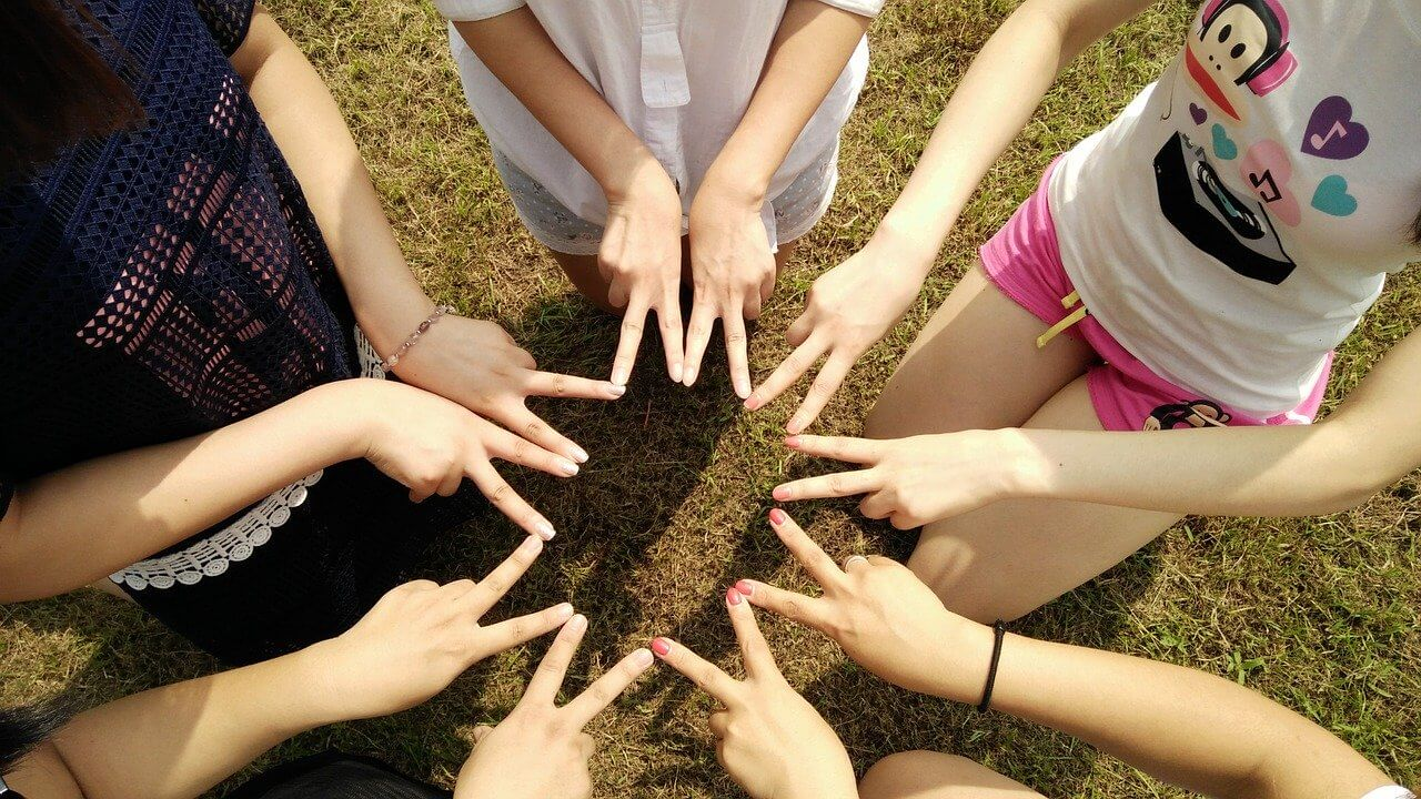 an image of a group of people with fingers together, signs of heroin addiction, heroin addiction treatment, heroin addiction stories, heroin addiction symptoms, why is heroin so addictive